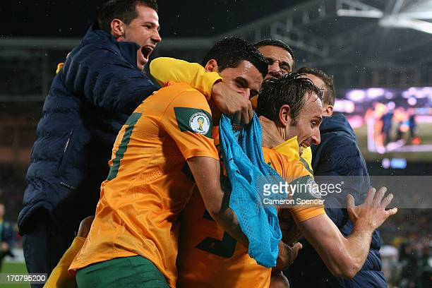 Tim Cahill and Tomas Rogic of the Socceroos celebrate with team mate Josh Kennedy after Kennedy scored a goal during the FIFA 2014 World Cup Asian...