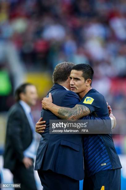 Tim Cahill hugs Ange Postecoglou of Australia after being substituted out in his 100th cap for the Australian national squad during the FIFA...