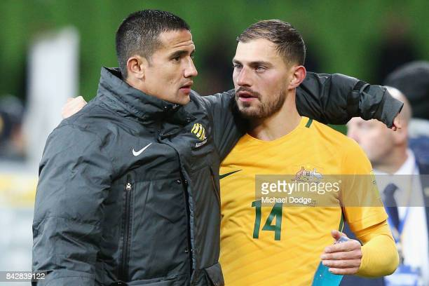 Tim Cahill hugs James Troisi of the Socceroos after the final whistle during the 2018 FIFA World Cup Qualifier match between the Australian Socceroos...