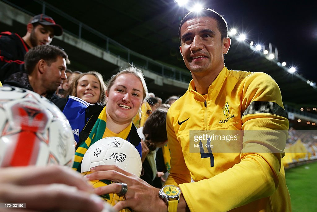 <a gi-track='captionPersonalityLinkClicked' href=/galleries/search?phrase=Tim+Cahill+-+Soccer+Player&family=editorial&specificpeople=209085 ng-click='$event.stopPropagation()'>Tim Cahill</a> interacts with fans during an Australian Socceroos training session at WIN Jubilee Stadium on June 13, 2013 in Sydney, Australia.