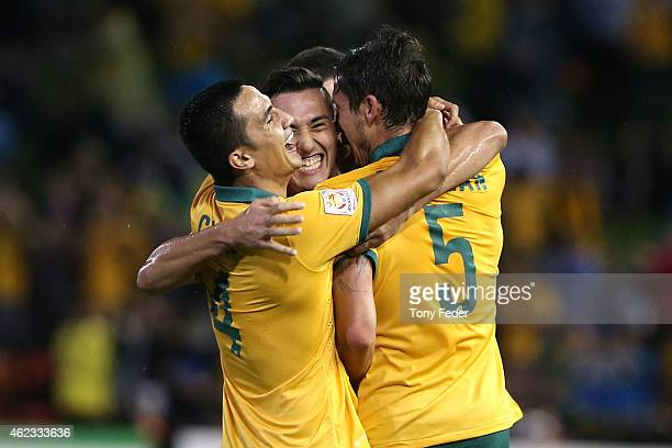 Tim Cahill Jason Davidson and Mark Milligan of Australia celebrate a goal during the Asian Cup Semi Final match between the Australian Socceroos and...