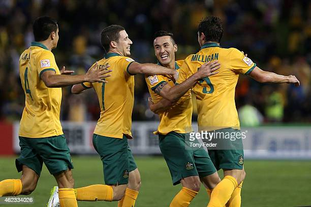 Tim Cahill Matthew Leckie Jason Davidson and Mark Milligan of Australia celebrate a goal during the Asian Cup Semi Final match between the Australian...