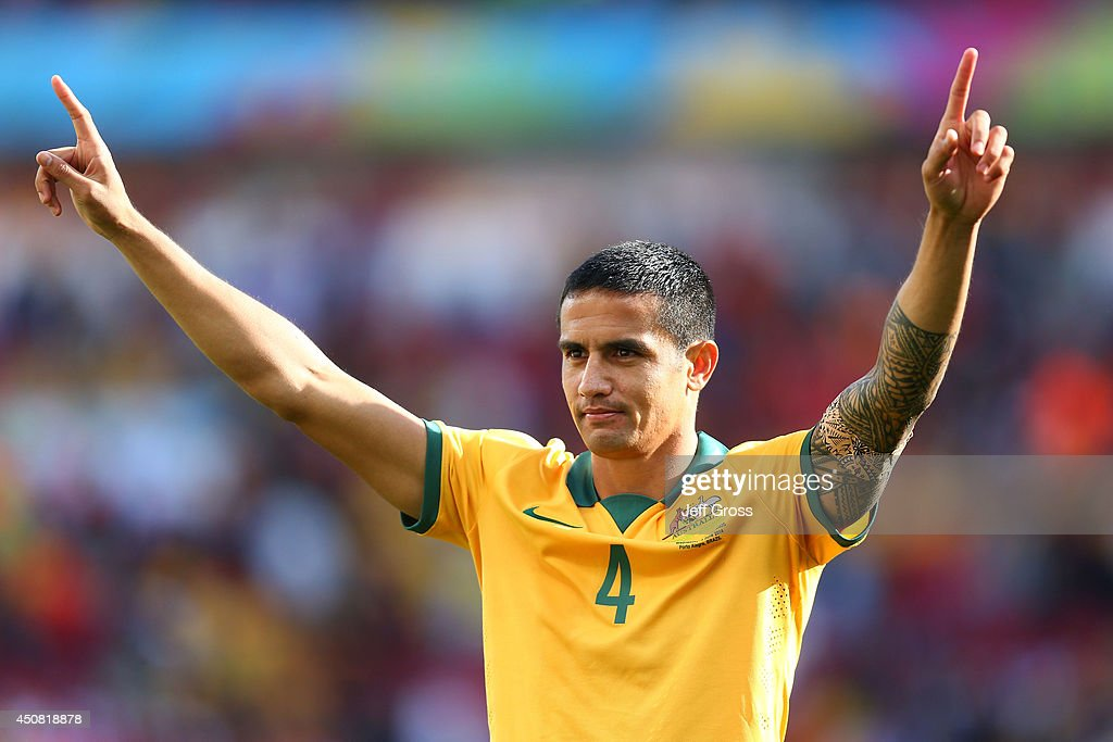 <a gi-track='captionPersonalityLinkClicked' href=/galleries/search?phrase=Tim+Cahill&family=editorial&specificpeople=209085 ng-click='$event.stopPropagation()'>Tim Cahill</a> of Australia acknowledges the fans after being defeated by the Netherlands 3-2 during the 2014 FIFA World Cup Brazil Group B match between Australia and Netherlands at Estadio Beira-Rio on June 18, 2014 in Porto Alegre, Brazil.