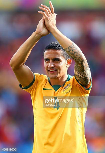 Tim Cahill of Australia acknowledges the fans after being defeated by the Netherlands 32 during the 2014 FIFA World Cup Brazil Group B match between...