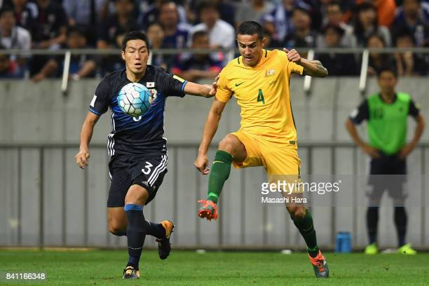 Tim Cahill of Australia and Gen Shoji of Japan compete for the ball during the FIFA World Cup Qualifier match between Japan and Australia at Saitama...