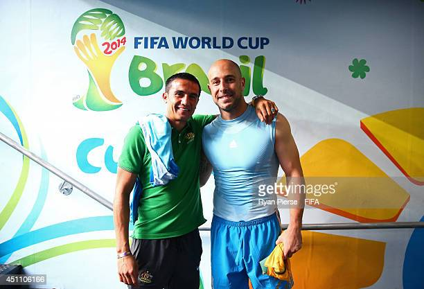 Tim Cahill of Australia and Pepe Reina of Spain pose for photographs after the 2014 FIFA World Cup Brazil Group B match between Australia and Spain...