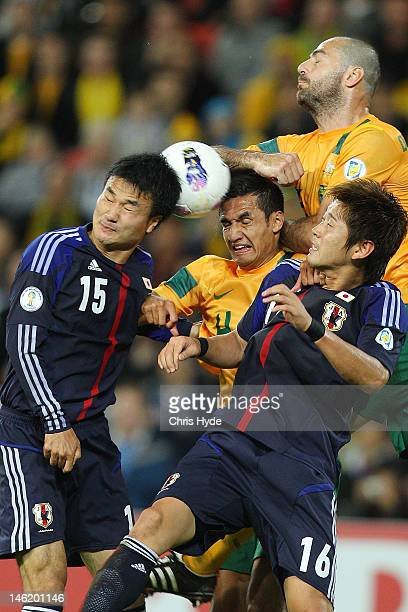 Tim Cahill of Australia and Yasuyuki Konno of Japan head the ball during the FIFA World Cup Asian Qualifier match between the Australian Socceroos...