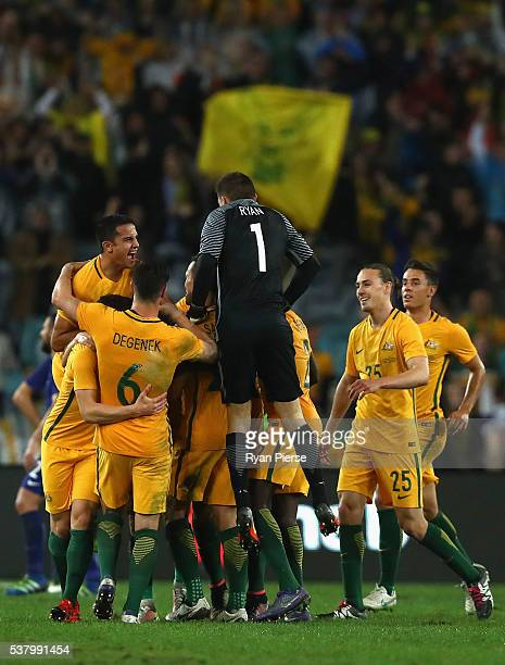 Tim Cahill of Australia celebrates after Mathew Leckie of Australia scored his teams first goal during the international friendly match between the...