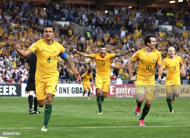 Tim Cahill of Australia celebrates after scoring his teams second goal during the 2018 FIFA World Cup Asian Playoff match between the Australian...