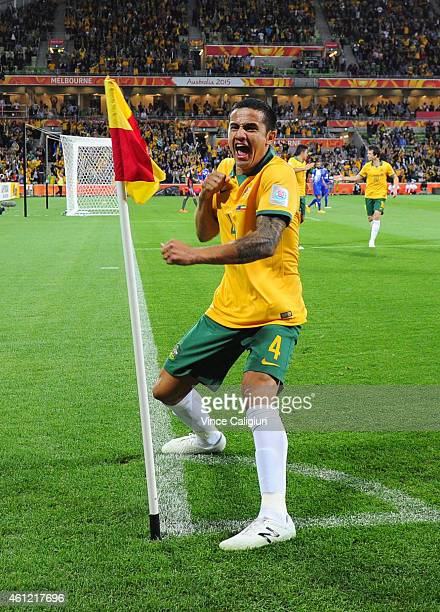Tim Cahill of Australia celebrates scoring his first goal in the first half during the 2015 Asian Cup match between the Australian Socceroos and...