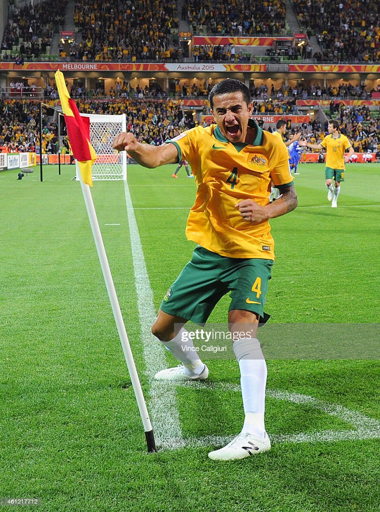 <a gi-track='captionPersonalityLinkClicked' href=/galleries/search?phrase=Tim+Cahill+-+Soccer+Player&family=editorial&specificpeople=209085 ng-click='$event.stopPropagation()'>Tim Cahill</a> of Australia celebrates scoring his first goal in the first half during the 2015 Asian Cup match between the Australian Socceroos and Kuwait at AAMI Park on January 9, 2015 in Melbourne, Australia.