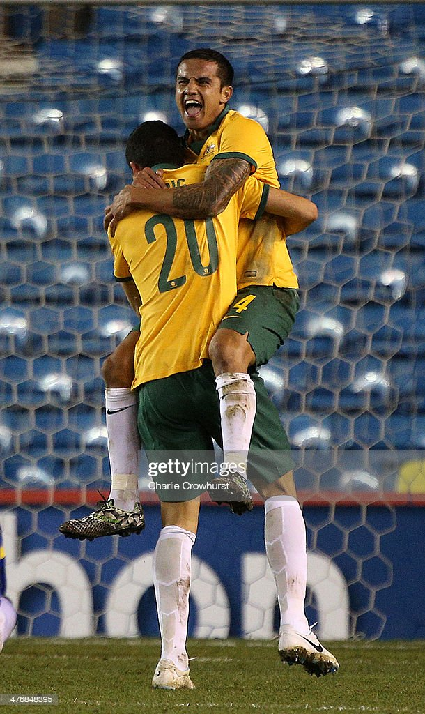 <a gi-track='captionPersonalityLinkClicked' href=/galleries/search?phrase=Tim+Cahill+-+Soccer+Player&family=editorial&specificpeople=209085 ng-click='$event.stopPropagation()'>Tim Cahill</a> of Australia celebrates scoring his second goal of the game during the International Friendly match between Australia and Ecuador at The Den on March 05, 2014 in London, England.