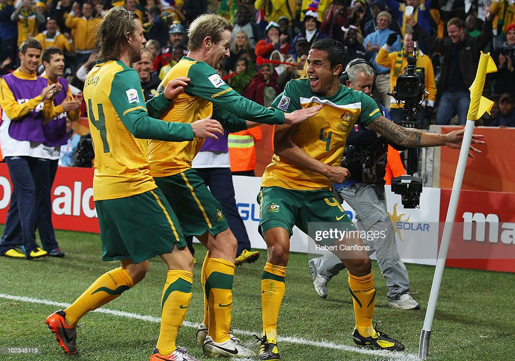 Tim Cahill of Australia celebrates scoring the opening goal with team mates David Carney and Brett Holman during the 2010 FIFA World Cup South Africa...