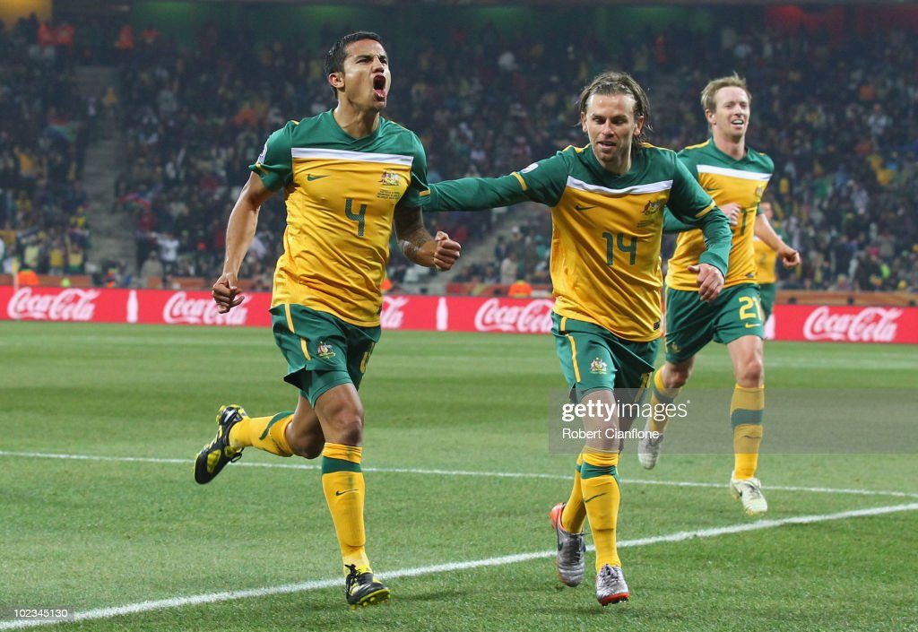 <a gi-track='captionPersonalityLinkClicked' href=/galleries/search?phrase=Tim+Cahill&family=editorial&specificpeople=209085 ng-click='$event.stopPropagation()'>Tim Cahill</a> of Australia (L) celebrates scoring the opening goal with team mates <a gi-track='captionPersonalityLinkClicked' href=/galleries/search?phrase=Brett+Holman&family=editorial&specificpeople=2224226 ng-click='$event.stopPropagation()'>Brett Holman</a> and David Carney (R) during the 2010 FIFA World Cup South Africa Group D match between Australia and Serbia at Mbombela Stadium on June 23, 2010 in Nelspruit, South Africa.