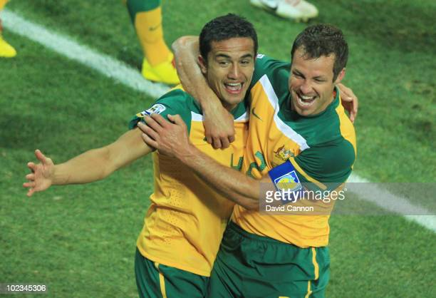Tim Cahill of Australia celebrates scoring the opening goal with team mate Lucas Neill during the 2010 FIFA World Cup South Africa Group D match...