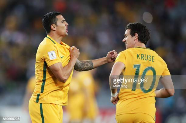 Tim Cahill of Australia celebrates with c after scoring their first goal during the 2018 FIFA World Cup Asian Playoff match between the Australian...
