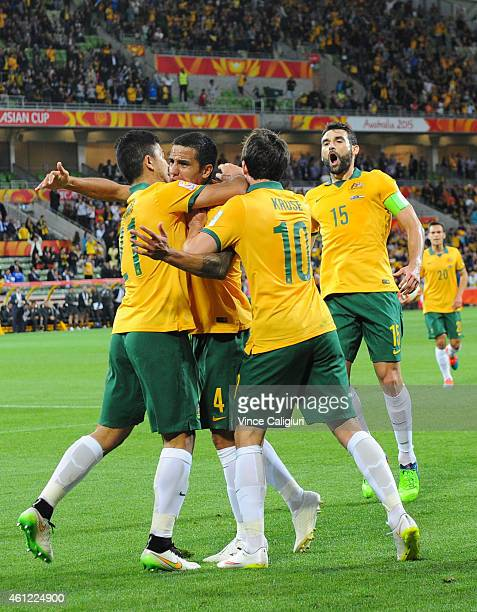 Tim Cahill of Australia celebrates with Massimo Luongo and Robbie Kruse after scoring his first goal in the first half during the 2015 Asian Cup...