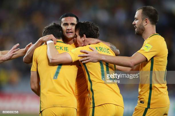 Tim Cahill of Australia celebrates with team mates after scoring their first goal during the 2018 FIFA World Cup Asian Playoff match between the...