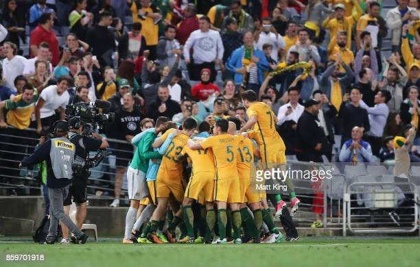 Tim Cahill of Australia celebrates with team mates after scoring their second goal during the 2018 FIFA World Cup Asian Playoff match between the...