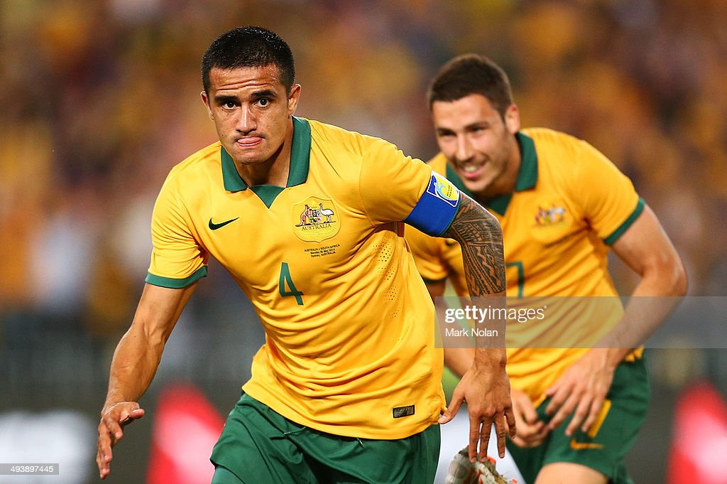 <a gi-track='captionPersonalityLinkClicked' href=/galleries/search?phrase=Tim+Cahill+-+Soccer+Player&family=editorial&specificpeople=209085 ng-click='$event.stopPropagation()'>Tim Cahill</a> of Australia celebtrates scoring a goal during the International Friendly match between the Australian Socceroos and South Africa at ANZ Stadium on May 26, 2014 in Sydney, Australia.