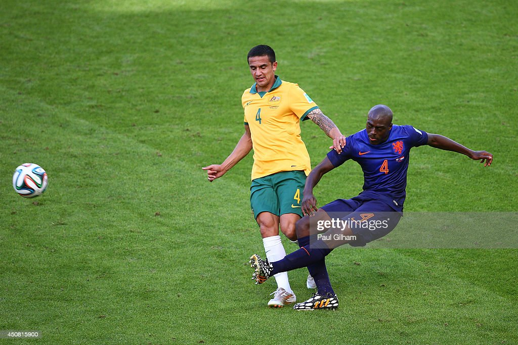 <a gi-track='captionPersonalityLinkClicked' href=/galleries/search?phrase=Tim+Cahill&family=editorial&specificpeople=209085 ng-click='$event.stopPropagation()'>Tim Cahill</a> of Australia challenges <a gi-track='captionPersonalityLinkClicked' href=/galleries/search?phrase=Bruno+Martins+Indi&family=editorial&specificpeople=7155940 ng-click='$event.stopPropagation()'>Bruno Martins Indi</a> of the Netherlands during the 2014 FIFA World Cup Brazil Group B match between Australia and Netherlands at Estadio Beira-Rio on June 18, 2014 in Porto Alegre, Brazil.