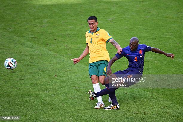 Tim Cahill of Australia challenges Bruno Martins Indi of the Netherlands during the 2014 FIFA World Cup Brazil Group B match between Australia and...