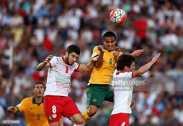 Tim Cahill of Australia competes for the ball wirh Eraj Rajabov and Nurriden Davronov of Tajikistan during the 2018 FIFA World Cup Qualifier match...
