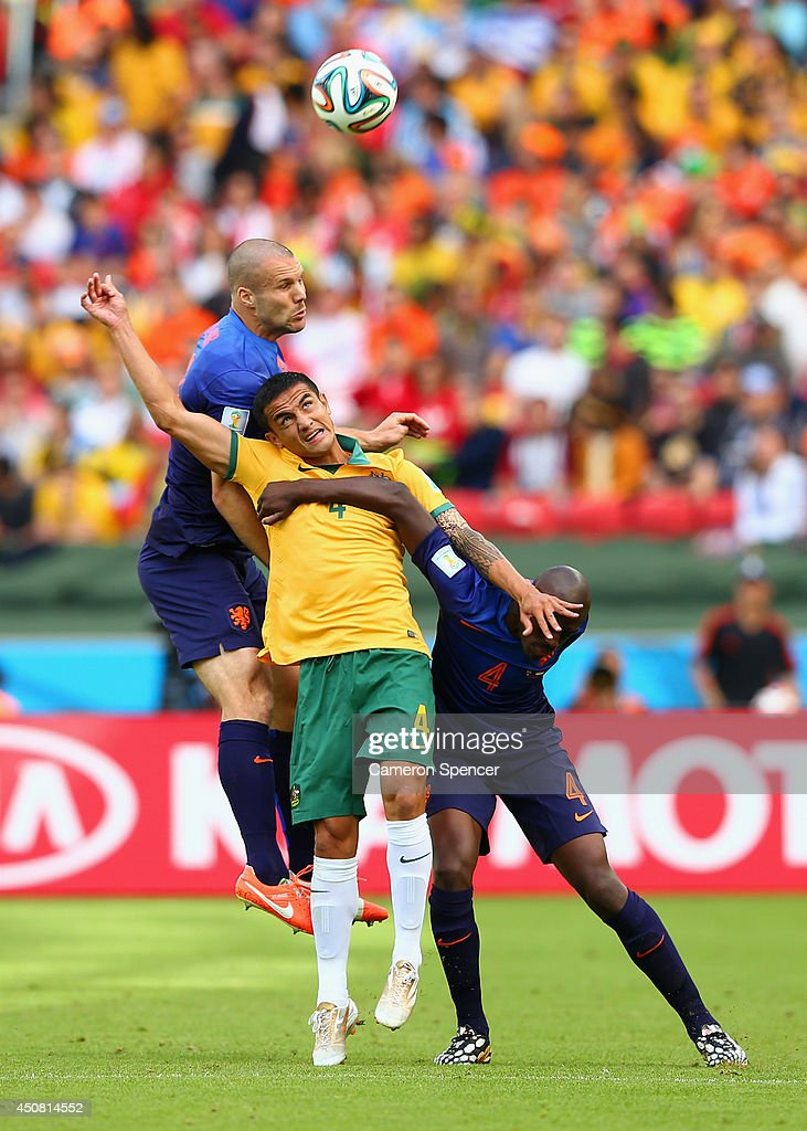 <a gi-track='captionPersonalityLinkClicked' href=/galleries/search?phrase=Tim+Cahill&family=editorial&specificpeople=209085 ng-click='$event.stopPropagation()'>Tim Cahill</a> of Australia competes for the ball with <a gi-track='captionPersonalityLinkClicked' href=/galleries/search?phrase=Ron+Vlaar&family=editorial&specificpeople=605352 ng-click='$event.stopPropagation()'>Ron Vlaar</a> (L) and <a gi-track='captionPersonalityLinkClicked' href=/galleries/search?phrase=Bruno+Martins+Indi&family=editorial&specificpeople=7155940 ng-click='$event.stopPropagation()'>Bruno Martins Indi</a> of the Netherlands during the 2014 FIFA World Cup Brazil Group B match between Australia and Netherlands at Estadio Beira-Rio on June 18, 2014 in Porto Alegre, Brazil.