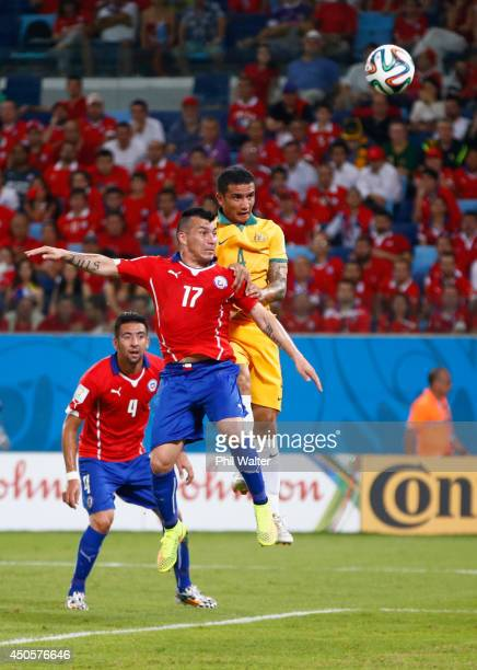 Tim Cahill of Australia goes up for a header against Gary Medel of Chile and scores a goal during the 2014 FIFA World Cup Brazil Group B match...