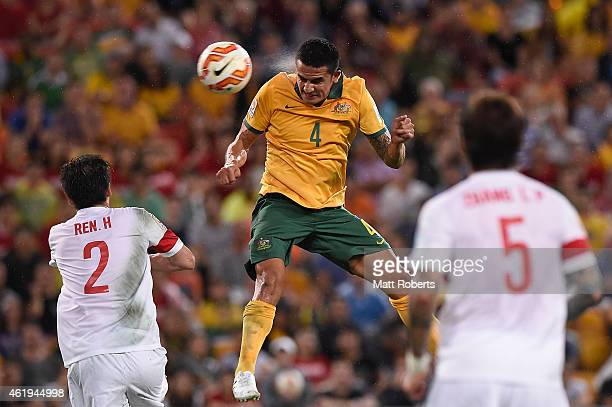 Tim Cahill of Australia heads the ball into the goal during the 2015 Asian Cup match between China PR and the Australian Socceroos at Suncorp Stadium...