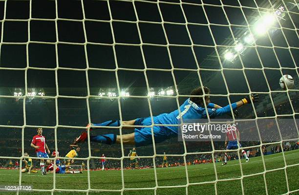 Tim Cahill of Australia heads the opening goal past Vladimir Stojkovic of Serbia during the 2010 FIFA World Cup South Africa Group D match between...