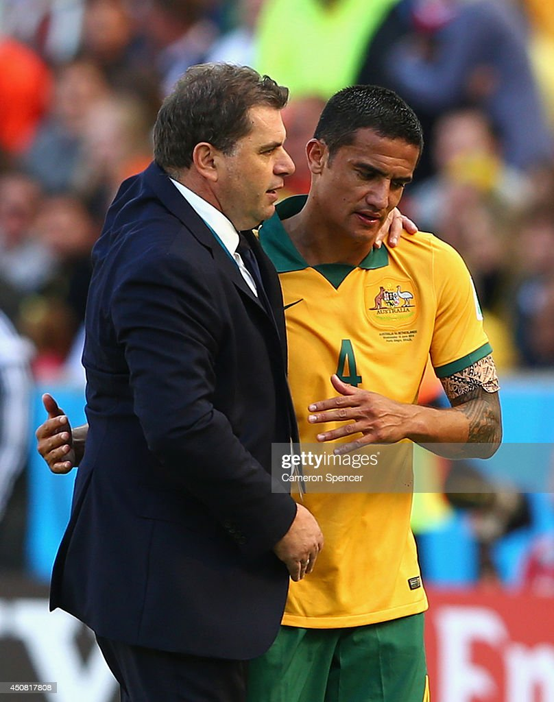 <a gi-track='captionPersonalityLinkClicked' href=/galleries/search?phrase=Tim+Cahill+-+Soccer+Player&family=editorial&specificpeople=209085 ng-click='$event.stopPropagation()'>Tim Cahill</a> of Australia hugs head coach <a gi-track='captionPersonalityLinkClicked' href=/galleries/search?phrase=Ange+Postecoglou&family=editorial&specificpeople=3395755 ng-click='$event.stopPropagation()'>Ange Postecoglou</a> after exiting the game during the 2014 FIFA World Cup Brazil Group B match between Australia and Netherlands at Estadio Beira-Rio on June 18, 2014 in Porto Alegre, Brazil.