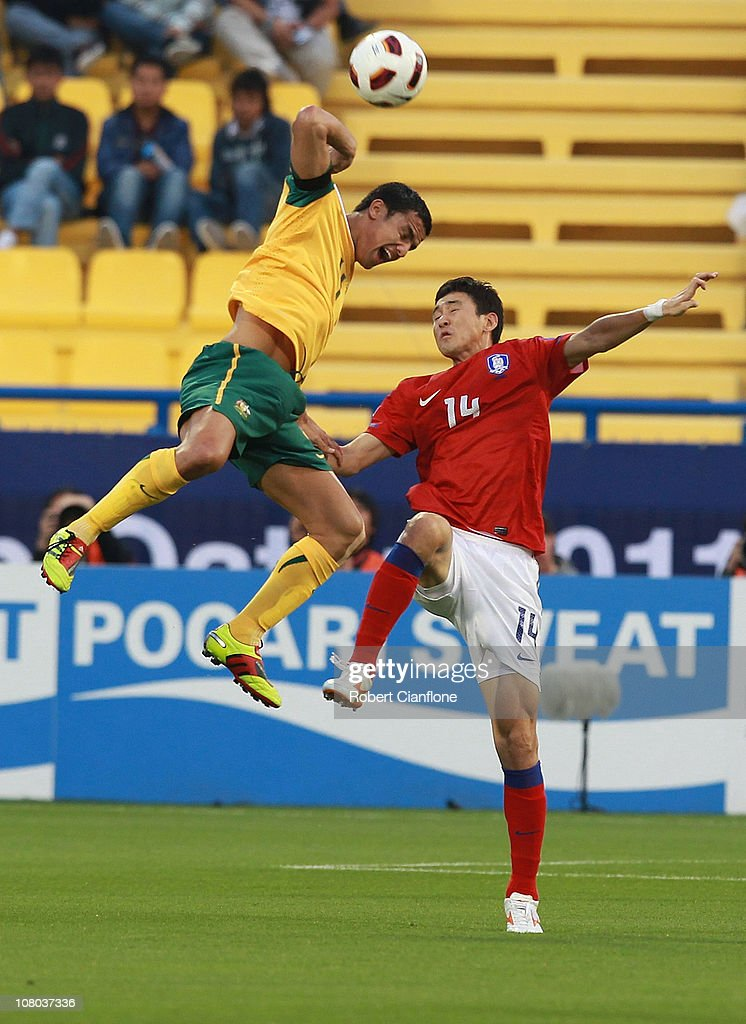 <a gi-track='captionPersonalityLinkClicked' href=/galleries/search?phrase=Tim+Cahill+-+Soccer+Player&family=editorial&specificpeople=209085 ng-click='$event.stopPropagation()'>Tim Cahill</a> of Australia is challenged by Lee Jung Soo of Korea Republic during the AFC Asian Cup Group C match between the Australian Socceroos and Korea Republic at Al-Gharafa Stadium on January 14, 2011 in Doha, Qatar.