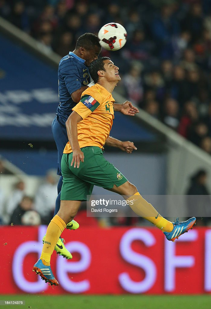 <a gi-track='captionPersonalityLinkClicked' href=/galleries/search?phrase=Tim+Cahill&family=editorial&specificpeople=209085 ng-click='$event.stopPropagation()'>Tim Cahill</a> of Australia is challenged by <a gi-track='captionPersonalityLinkClicked' href=/galleries/search?phrase=Patrice+Evra&family=editorial&specificpeople=714865 ng-click='$event.stopPropagation()'>Patrice Evra</a> during the International Friendly match between France and Australia at Parc des Princes on October 11, 2013 in Paris, France.