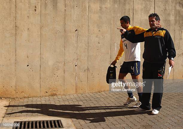 Tim Cahill of Australia jokes around with team manager Gary Moretti as he arrives for an Australian Socceroos training session at Ruimsig Stadium on...