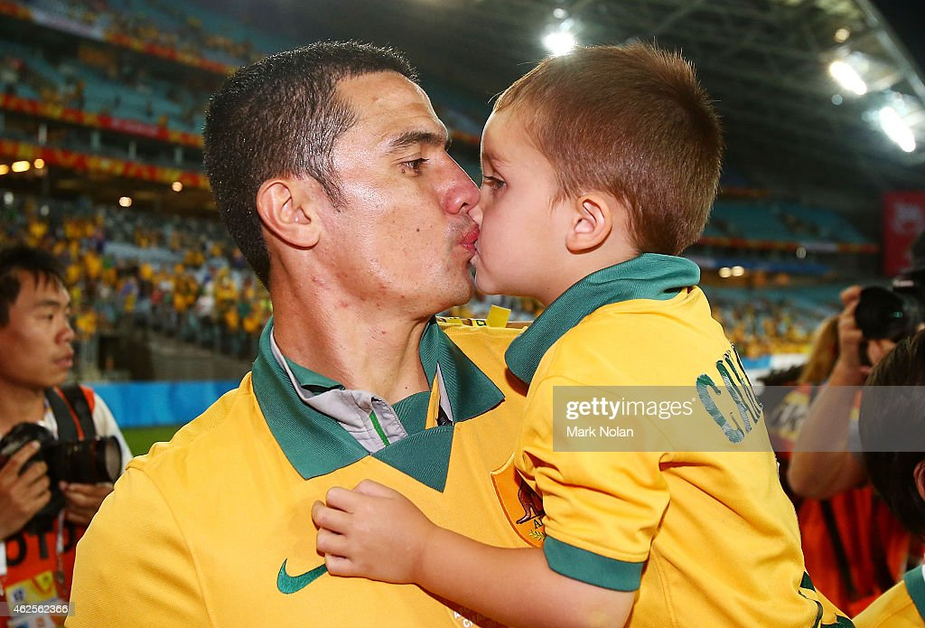 Tim Cahill of Australia kisses his son Cruz Cahill on the victory lap after the 2015 Asian Cup final match between Korea Republic and the Australian Socceroos at ANZ Stadium on January 31, 2015 in Sydney, Australia.
