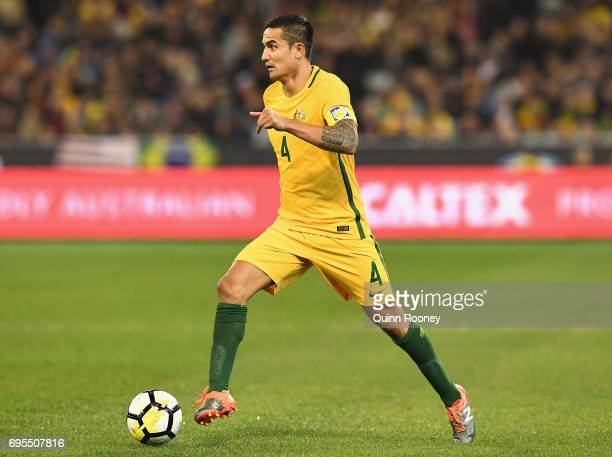 Tim Cahill of Australia looks to pass the ball during the Brasil Global Tour match between Australian Socceroos and Brazil at Melbourne Cricket...