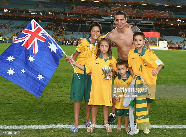 Tim Cahill of Australia poses with his children after Australia defeated Korea republic at the 2015 Asian Cup final match between Korea Republic and...