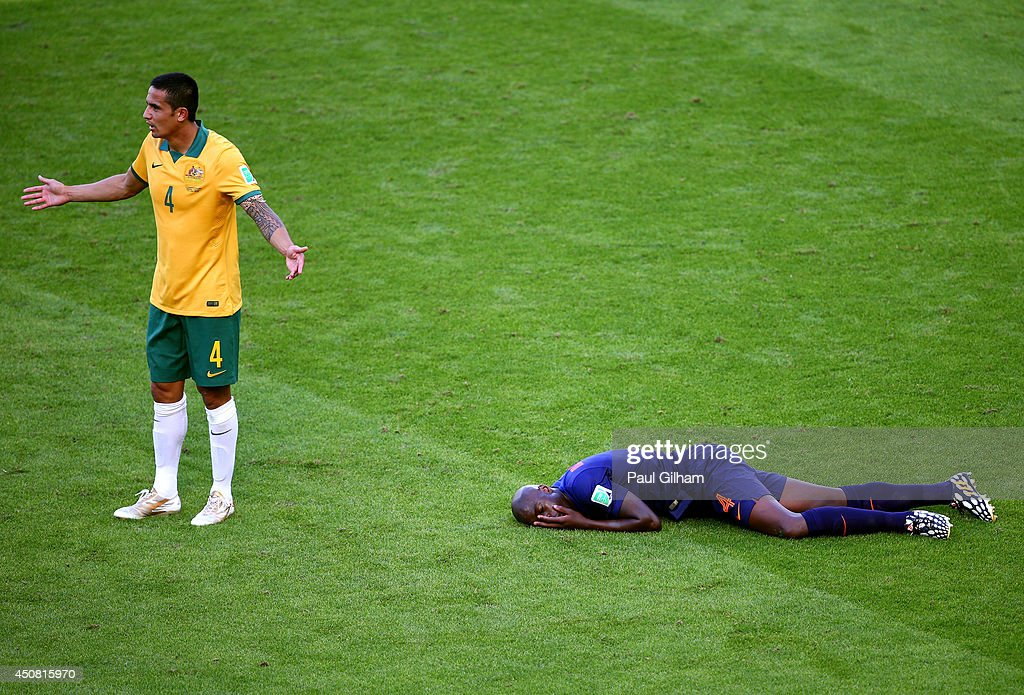 <a gi-track='captionPersonalityLinkClicked' href=/galleries/search?phrase=Tim+Cahill+-+Soccer+Player&family=editorial&specificpeople=209085 ng-click='$event.stopPropagation()'>Tim Cahill</a> of Australia reacts after a challenge on <a gi-track='captionPersonalityLinkClicked' href=/galleries/search?phrase=Bruno+Martins+Indi&family=editorial&specificpeople=7155940 ng-click='$event.stopPropagation()'>Bruno Martins Indi</a> of the Netherlands during the 2014 FIFA World Cup Brazil Group B match between Australia and Netherlands at Estadio Beira-Rio on June 18, 2014 in Porto Alegre, Brazil.