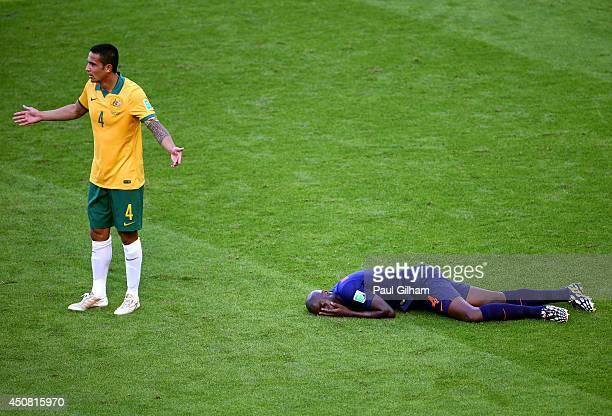 Tim Cahill of Australia reacts after a challenge on Bruno Martins Indi of the Netherlands during the 2014 FIFA World Cup Brazil Group B match between...
