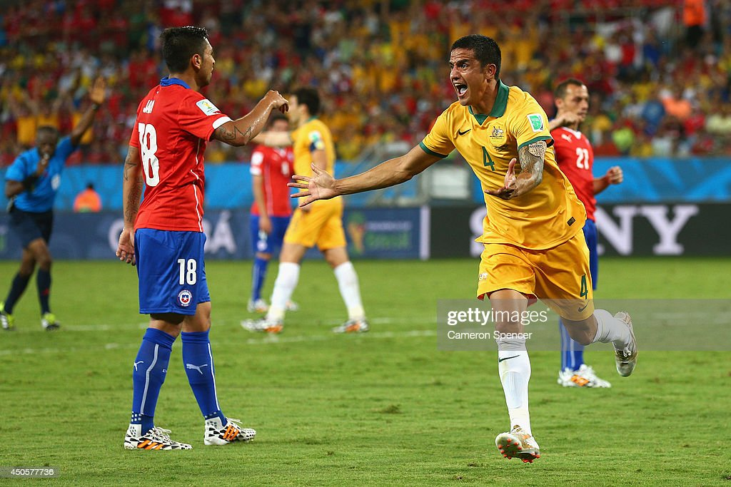 <a gi-track='captionPersonalityLinkClicked' href=/galleries/search?phrase=Tim+Cahill&family=editorial&specificpeople=209085 ng-click='$event.stopPropagation()'>Tim Cahill</a> of Australia reacts after a disallowed goal during the 2014 FIFA World Cup Brazil Group B match between Chile and Australia at Arena Pantanal on June 13, 2014 in Cuiaba, Brazil.