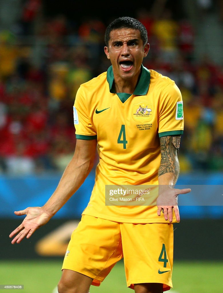 <a gi-track='captionPersonalityLinkClicked' href=/galleries/search?phrase=Tim+Cahill&family=editorial&specificpeople=209085 ng-click='$event.stopPropagation()'>Tim Cahill</a> of Australia reacts after having a goal disallowed during the 2014 FIFA World Cup Brazil Group B match between Chile and Australia at Arena Pantanal on June 13, 2014 in Cuiaba, Brazil.