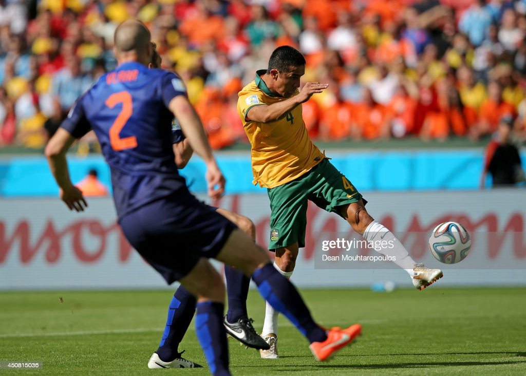 Tim Cahill of Australia shoots and scores his team's first goal during the 2014 FIFA World Cup Brazil Group B match between Australia and Netherlands at Estadio Beira-Rio on June 18, 2014 in Porto Alegre, Brazil.