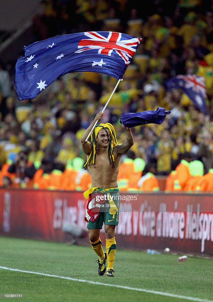 <a gi-track='captionPersonalityLinkClicked' href=/galleries/search?phrase=Tim+Cahill+-+Soccer+Player&family=editorial&specificpeople=209085 ng-click='$event.stopPropagation()'>Tim Cahill</a> of Australia smiles at fans after victory in the game but elimination from the tournament after the 2010 FIFA World Cup South Africa Group D match between Australia and Serbia at Mbombela Stadium on June 23, 2010 in Nelspruit, South Africa.