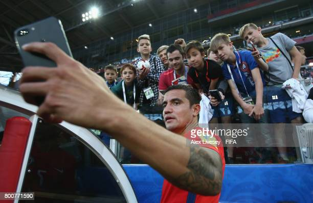Tim Cahill of Australia takes a selfie photograph with fans after the FIFA Confederations Cup Russia 2017 Group B match between Chile and Australia...