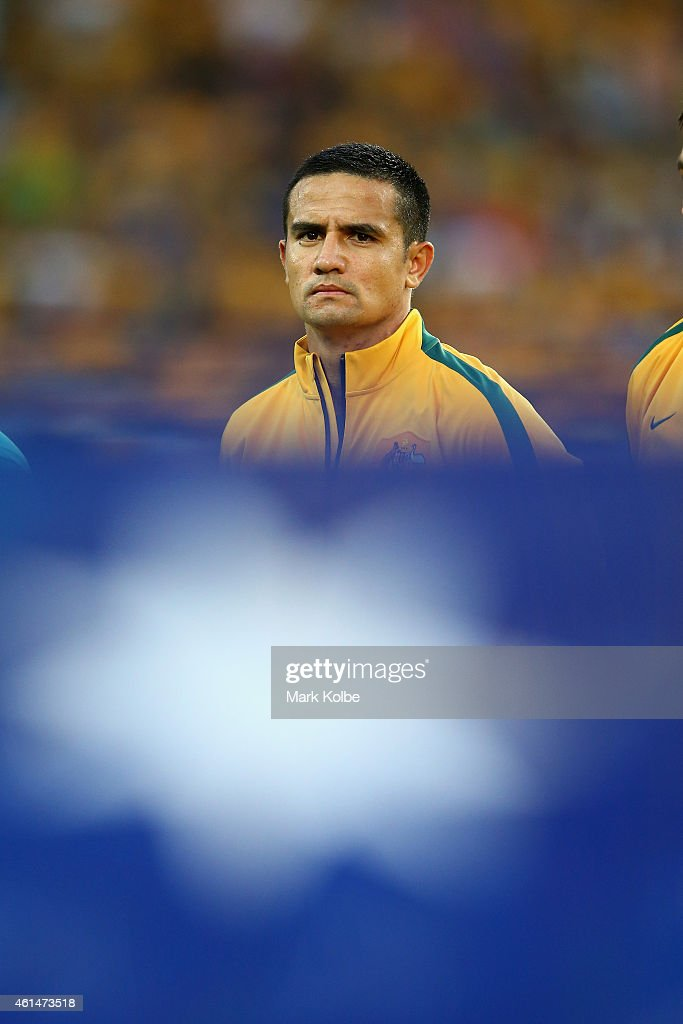 <a gi-track='captionPersonalityLinkClicked' href=/galleries/search?phrase=Tim+Cahill+-+Voetballer&family=editorial&specificpeople=209085 ng-click='$event.stopPropagation()'>Tim Cahill</a> of Australia watches on during the anthems during the 2015 Asian Cup match between Oman and Australia at ANZ Stadium on January 13, 2015 in Sydney, Australia.