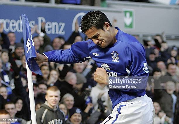 Tim Cahill of Everton celebrates scoring his first goal by boxing the corner flag during the Barclays Premiership match between Everton and Aston...