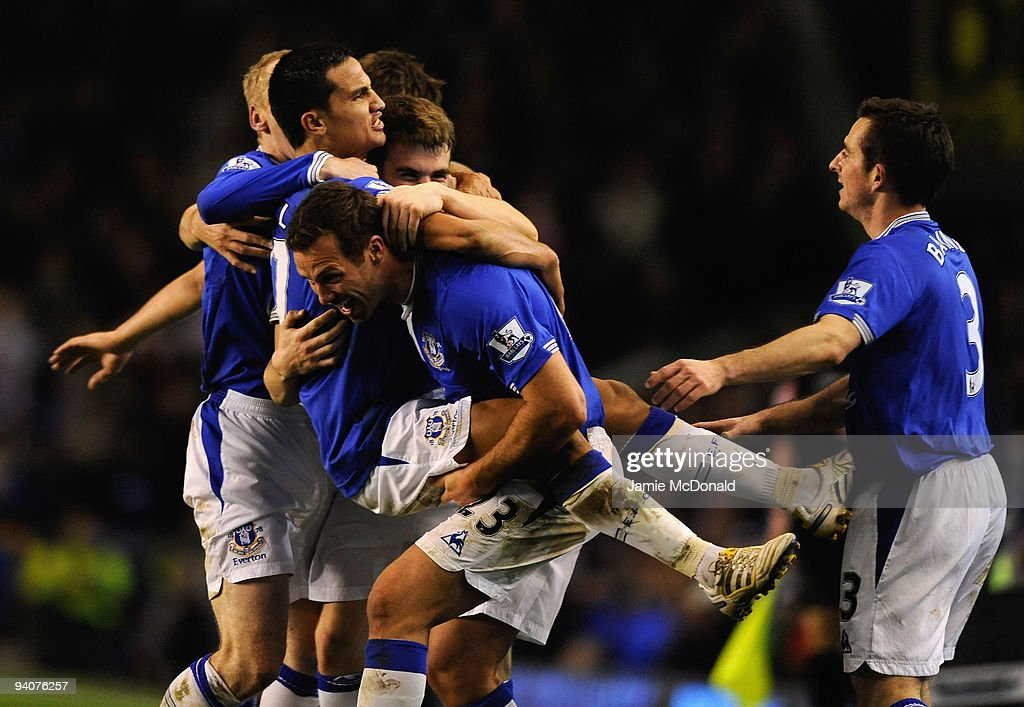 Tim Cahill of Everton celebrates scoring his team's second goal with his team mates during the Barclays Premier League match between Everton and Tottenham Hotspur at Goodison Park on December 6, 2009 in Liverpool, England.
