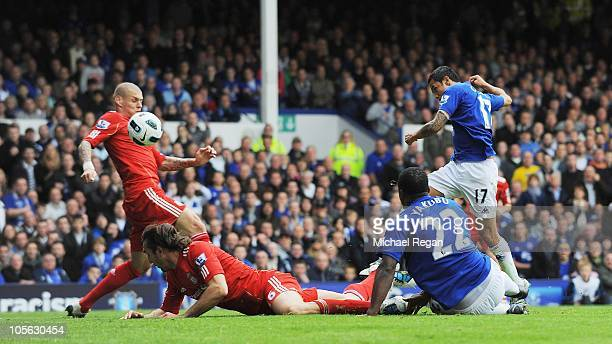 Tim Cahill of Everton scores the opening goal during the Barclays Premier League match between Everton and Liverpool at Goodison Park on October 17...