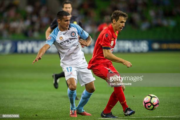 Tim Cahill of Melbourne City and Isaias of Adelaide United contest the ball during the round 26 match of the Hyundai ALeague between Adelaide United...